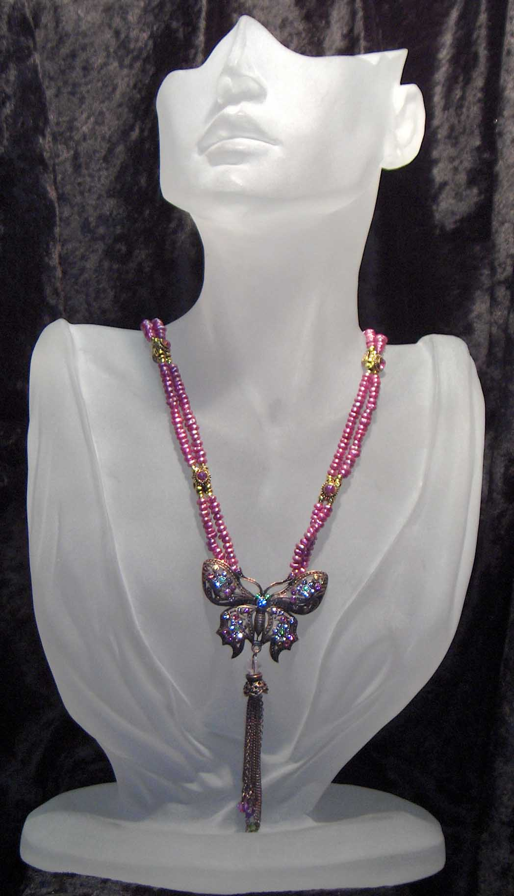 Dark pink fresh water pearls with crystal butterfly pendant